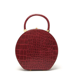 the round wicker and leather bag